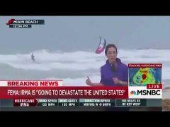 Reckless kitesurfer ignores evacuation order to ride huge waves on Miami beach in Hurricane Irma