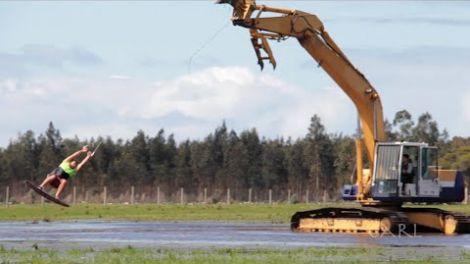 Wild tradies use excavator for water skiing, wakeboarding, big 360 airs